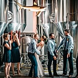 This brewery wedding featured bridesmaids and groomsmen in shades of teal.