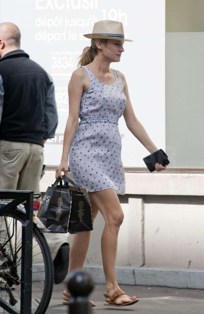Diane Kruger left Lina's restaurant in Paris today in a floral-print sundress and a straw hat. Diane and Joshua Jackson were at the Chanel Haute Couture show last night, though she was without her longtime boyfriend as she stepped out for a bite to go today. The couple have been spending some time in France for the past few weeks as he enjoys his hiatus from Fringe, shopping the Parisian boutiques, partying with famous friends, and attending charity galas. Diane and Joshua have made their long-distance relationship work for several years. The jet-setting couple often reunite for romantic European getaways, especially during Fashion Week, where they are frequent fixtures in the front row. Not surprisingly, Diane's winning red carpet and street style made her one of your PopSugar 100 celebrity style faves this year.