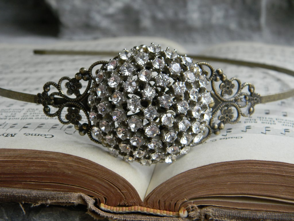 Aren't the holidays all about bringing on the bling? Slide on this Victorian headband ($112) for instant glamour.