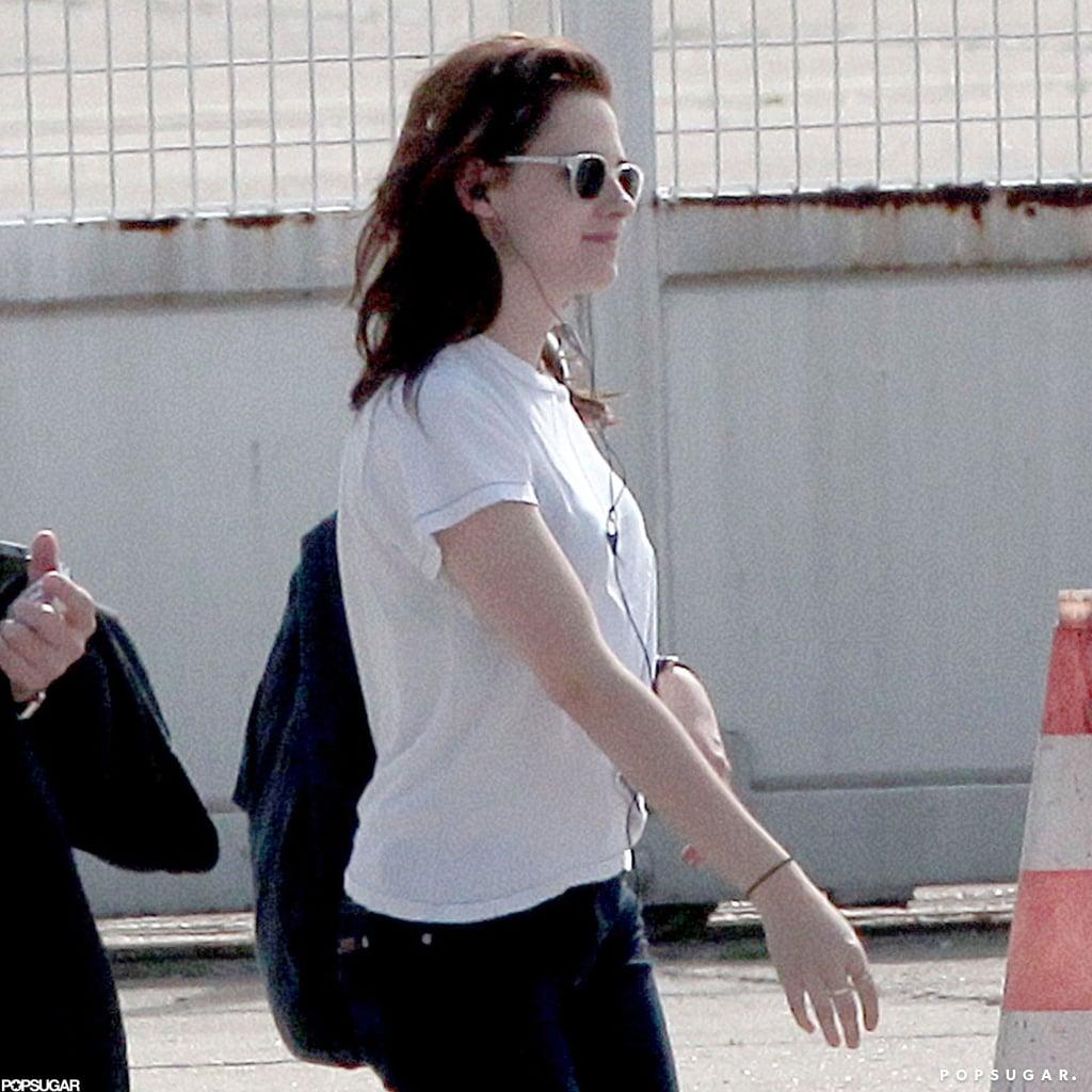 Kristen Stewart wore a white shirt and sunglasses.