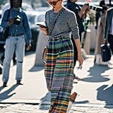 Wide, multi-colored pants feel easy with a simple gray knit.