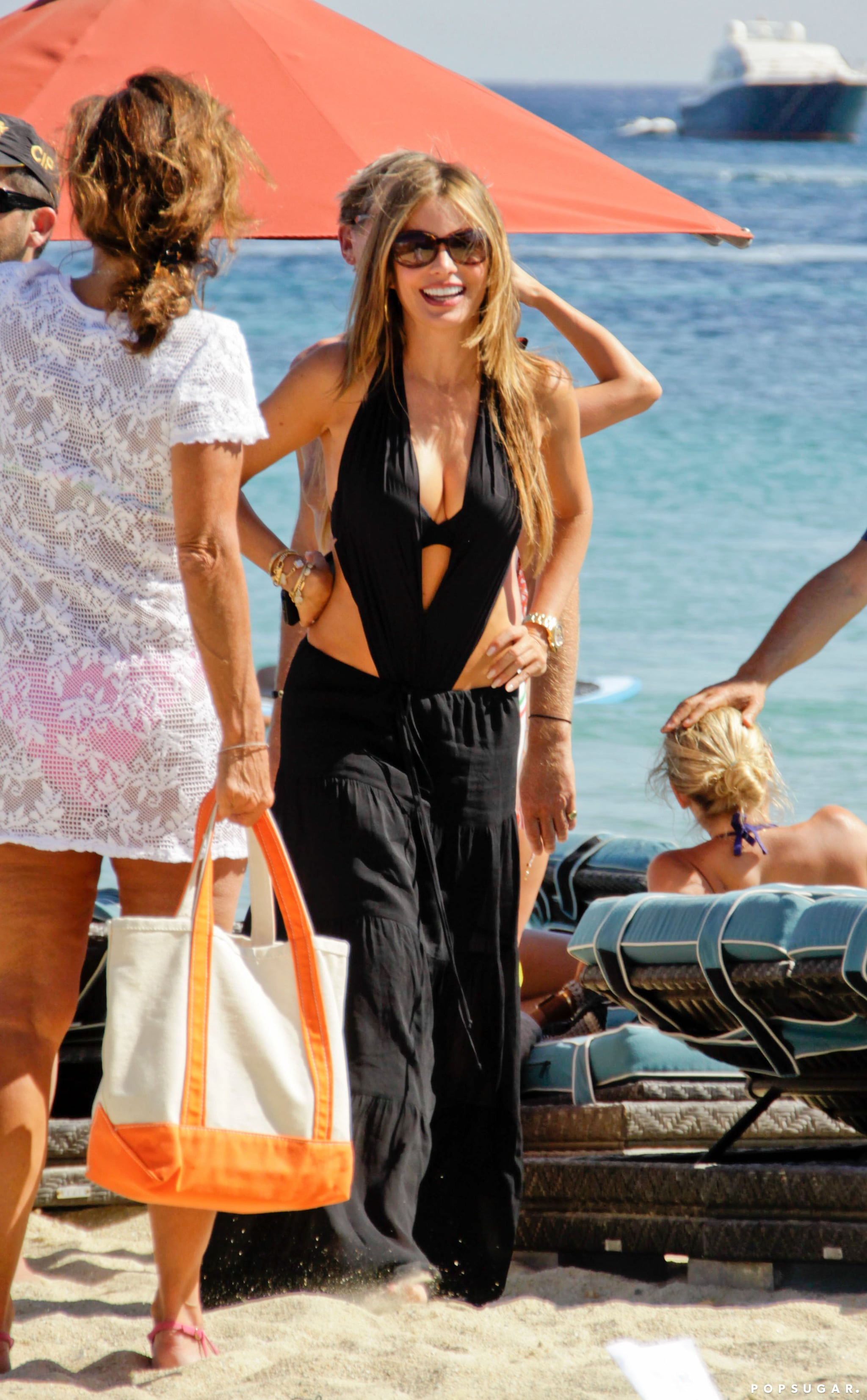 Sofia Vergara hit the beach in Mykonos while wearing a maxi skirt in July 2013.