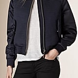 """""""It's not just the lightweight layering options that come with bomber jackets that I love so much; it's their sporty appeal. I've always been a midnight-navy girl, so this quilted Burberry number (1,195), finished with leather piping, really spoke to me."""" — SW"""