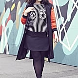 Layer a sleek black vest over a colour-pop jumper to add a grown-up edge to the entire outfit.