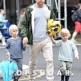 Liev Schreiber held Kai and Sasha's hands in rainy NYC on Saturday ahead of Mother's Day.