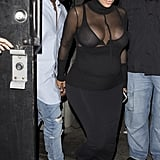 Kim Kardashian worked the sheer black turtleneck into her maternity style by pairing it with a supertight high-rise skirt. She added her trusty heels for a night out.