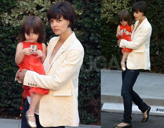 Photos of Katie Holmes and Suri Cruise Holding $100 Bill