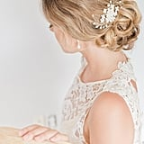 A combination of freshwater pearls and Swarovski crystals give this comb a sophisticated touch. If you want to wear your hair up for your big day, this handmade piece ($95) is way more gorgeous than bobby pins.