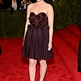 Don't let the sweetheart neckline on Kate Mara's Delpozo dress fool you: the bodice is studded with spikes!