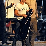 Zac Efron filmed while wearing a frat t-shirt.