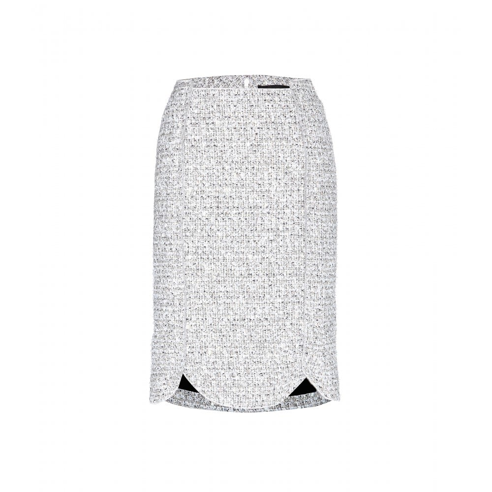 "Nothing says ""Fall"" to me like a tweed pencil skirt — the problem is I always feel a bit too conservative when I wear the classic style. Proenza Schouler's scalloped design ($896) is almost more sporty than studious in the schoolyard spectrum, and is subtle enough to go with my boldest Autumn prints. — RM"