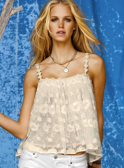 A delicate femme tank for pairing with flared jeans and cutoff shorts.  Victoria's Secret Flyaway Cami ($40, originally $48)