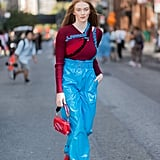 This Model Wore a Burgundy Sweater With Bright Blue Paperbag-Waist Pants