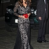 Kate Middleton is not only a fan of Temperley London, but she also can't stay away from a great lace gown. And we can't blame her. It's beautiful, formal, and complements that bold red clutch like a dream.