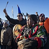 Activists play music at the reservation's Oceti Sakowin Camp.