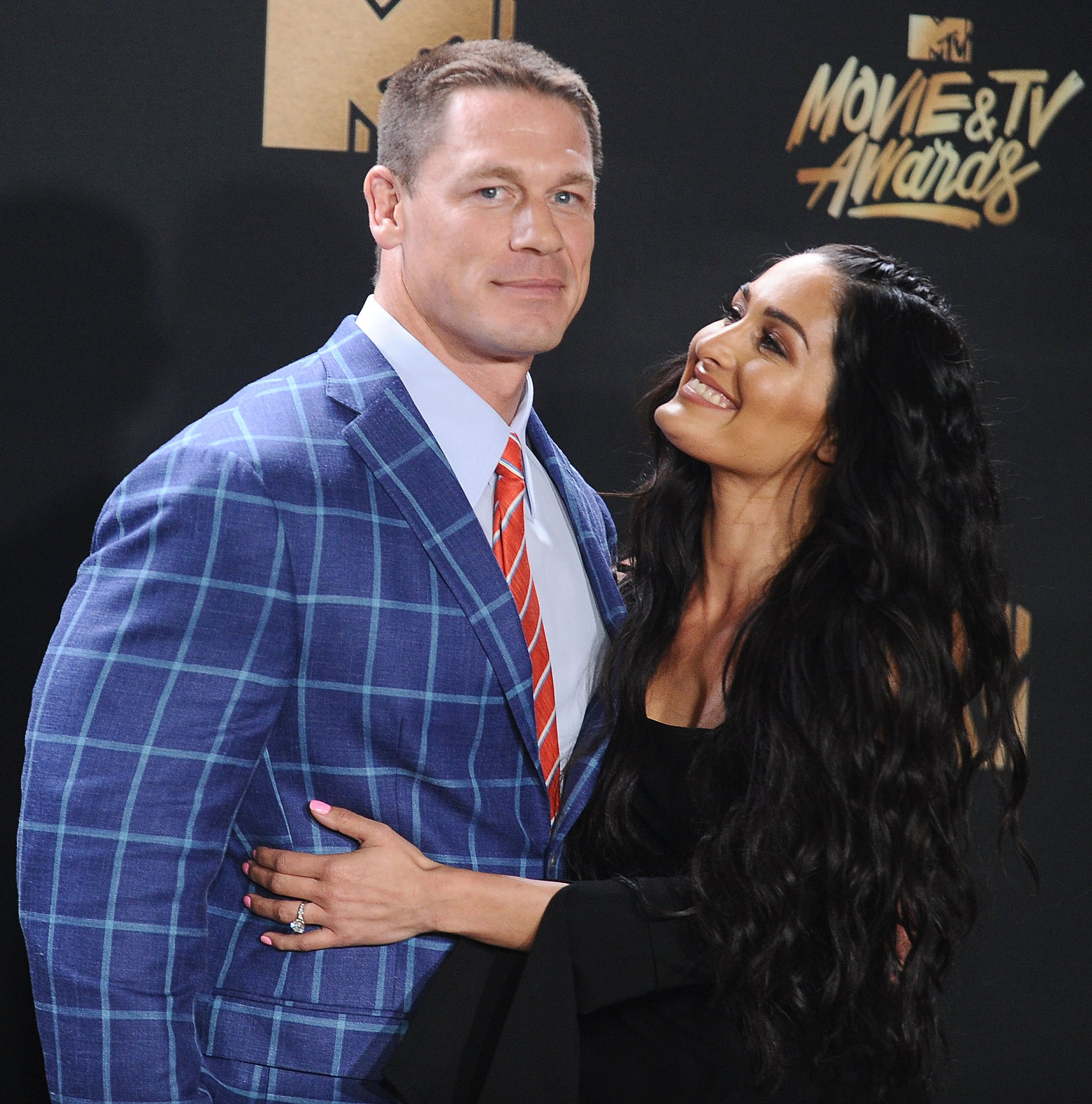 LOS ANGELES, CA - MAY 07:  John Cena and Nikki Bella pose in the press room at the 2017 MTV Movie and TV Awards at The Shrine Auditorium on May 7, 2017 in Los Angeles, California.  (Photo by Jason LaVeris/FilmMagic)