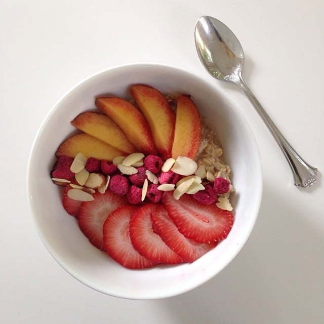 Well isn't this just Summer in a bowl — strawberries, almonds, dried raspberries, and a peach.