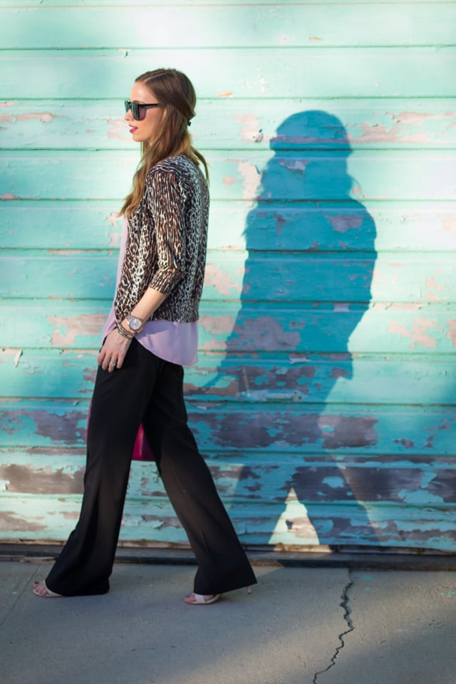 A simple black wide-leg trouser gets a casual touch with layered separates of varying lengths.