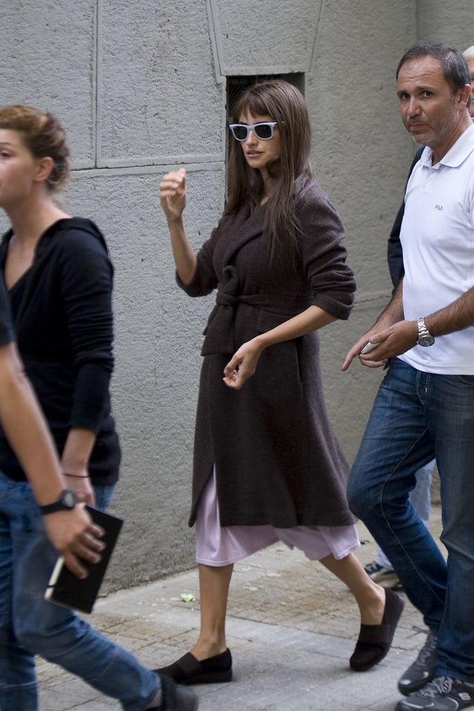 Penelope Cruz wore a dark robe.