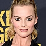 Margot played up the sparkle by completing her look with edgy stud earrings.