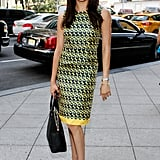 Meghan's sheath dress featured a busy print and a splash of yellow while out in new York in September 2013.