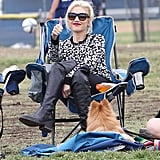 Back in September, Gwen sat stylishly on the sidelines to watch her son's soccer game in a printed sweater, leggings, and knee-high boots. She completed her carefree look with a pair of shades.