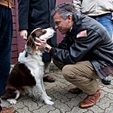 Jon Huntsman kisses a dog in New Hampshire during his campaign.