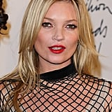 Kate Moss went for a bold red lip at the British Fashion Awards.