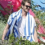 Andrew Garfield had a towel around his neck at the beach.