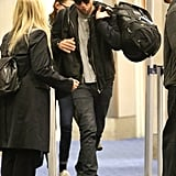 Robert Pattinson carried his duffle.