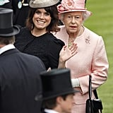 She waved to the photographers while standing with Queen Elizabeth II at the Royal Ascot in 2013.