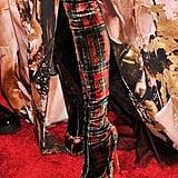 Sarah Jessica Parker wore plaid Christian Louboutin boots.