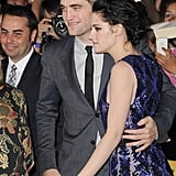 Robert Pattinson put his arm around Kristen Stewart's waist.