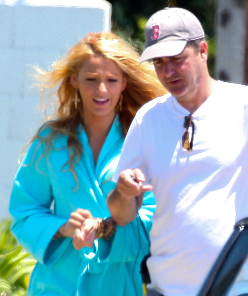 Blake Lively covered up under a blue robe.