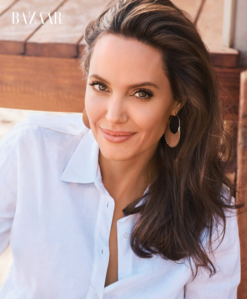 Angelina wore a Gabriela Hearst blouse with her own earrings.