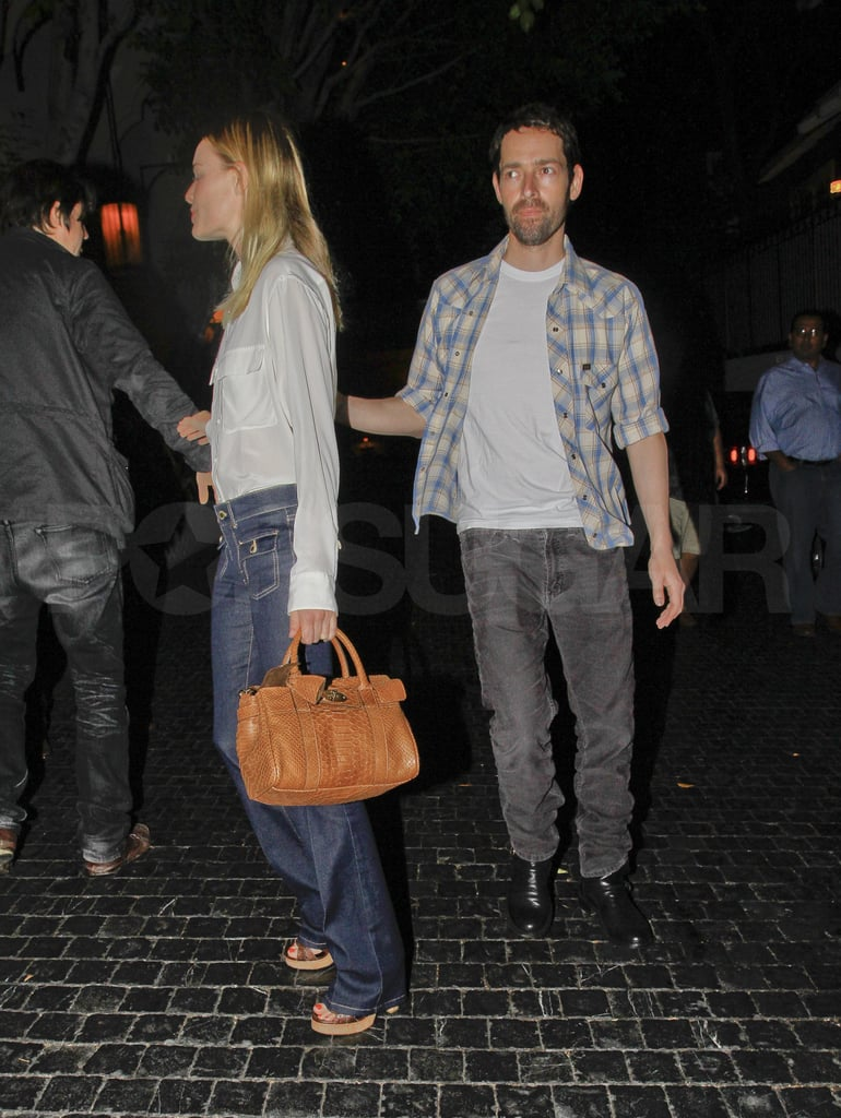 Kate Bosworth paired a neutral bag with her classic denim.