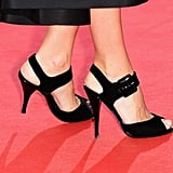 Audrey Tautou wore black buckle sandals.