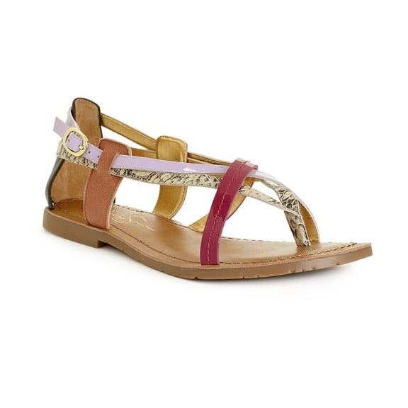Jessica Simpson may be known for her supertall heels, but these tricolored woven sandals have plenty of feminine sweetness.  Jessica Simpson Jamilia Flat Sandals in Lavendar Snake Combo ($59)