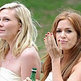 Isla Fisher and Kirsten Dunst filmed in a NYC park.