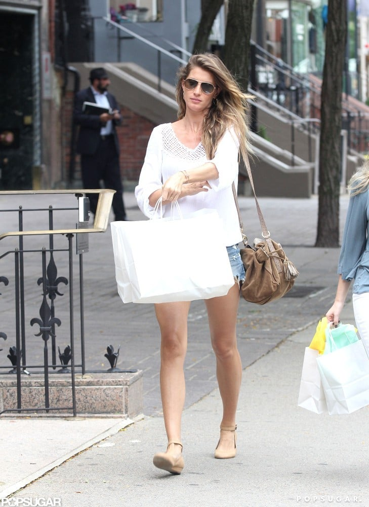 Gisele Bundchen was dressed in short denim shorts and a white top while shopping along Boston's Newbury Street earlier today. The pregnant supermodel is back in Boston prepping for a big weekend with her boys. Tom Brady and the New England Patriots officially kick off their 2012 season on Sunday with an away game against the Tennessee Titans. There's no word on if Gisele will make the trip to Tennessee with Tom, or if she'll hang at home and spend the day at their favorite park.