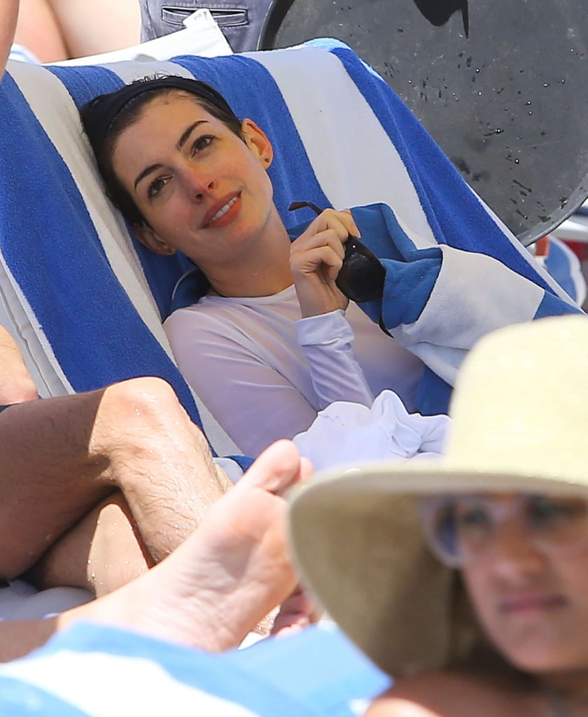 Anne Hathaway Heats Up Miami With Beachside PDA