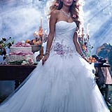 "This Alfred Angelo ""Sleeping Beauty"" gown has pink floral detailing on the bodice reminiscent of Aurora's gown."