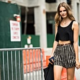 Model-off-duty cool in striped shorts and, of course, a crop top.