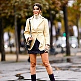 Between seasons, style your mini with a dressy jacket, slim-fitting turtleneck, and mid-calf boots.