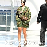 Rihanna Wearing Bottega Veneta Sandals and a Miu Miu Cardigan at the Airport