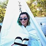 Katy Perry wrapped up in a tent.