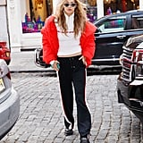 Not the one to miss out on trends, Gigi stepped out in a red H&M puffer coat on Nov 2017.