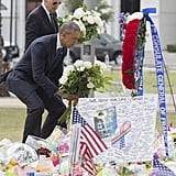 The two lay flowers at the memorial at the Dr. Phillips Center For the Performing Arts in Orlando.