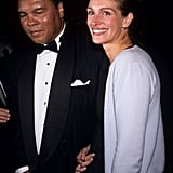 Julia smiled with Muhammad Ali at an Amnesty International party in 1998.