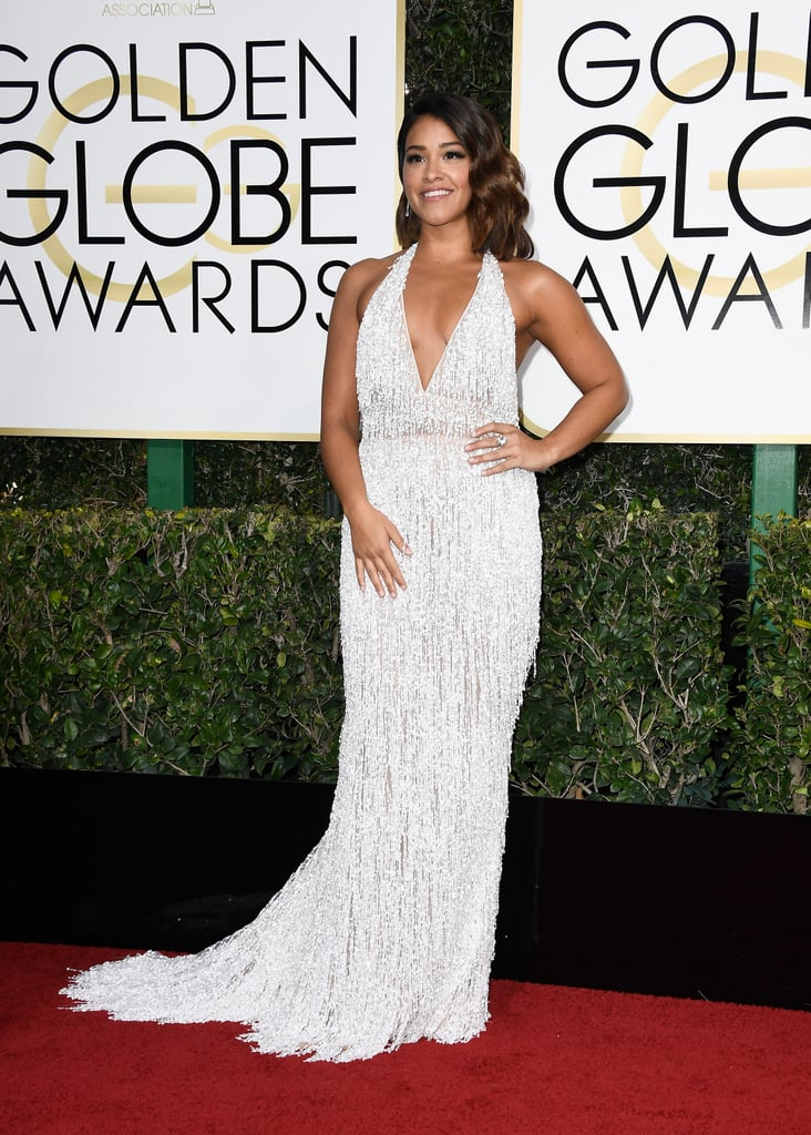 "No surprise here: Gina Rodriguez turned heads at the 2017 Golden Globe Awards in Beverly Hills, CA, on Jan. 8. The Jane the Virgin actress, who received her third consecutive nomination this year for her role as Jane, wore a trendy, 1920s-inspired plunging halter metallic fringe Naeem Khan dress, Chopard jewels, and Giuseppe Zanotti heels to the star-studded event, practically shutting down the red carpet with her guest of the night: her older sister, Rebecca. (She brought her dad last year!)  Gina gave her social media followers a sneak peek of the look, sharing a few photos of the getting-ready process and a nice message of gratitude: ""Today is a great day, I can and I will,"" she wrote, quoting her 2015 acceptance speech, ""3rd nomination, 4th season renewal and family, friends, cast, and supporters that have all helped me get here."" Keep scrolling to see more pictures of Gina's sultry backless dress, then admire her Hollywood style evolution.      Related:                                                                                                           A Look Back at Some of the Most Memorable Dresses of Golden Globe Awards Past"